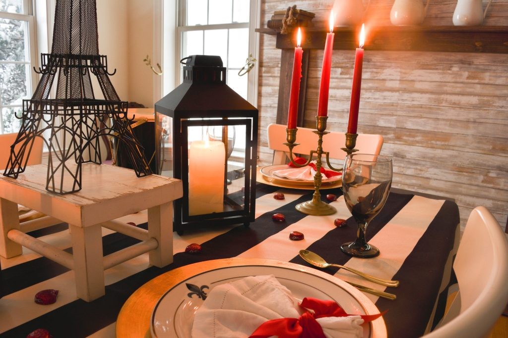 Valentine's Day in Paris themed tablescape with the Eiffel Tower and fleur-de-lis plates