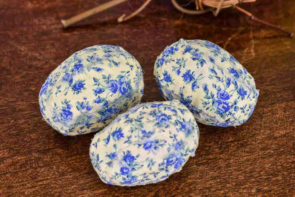 plastic Easter eggs covered with blue and yellow floral fabric