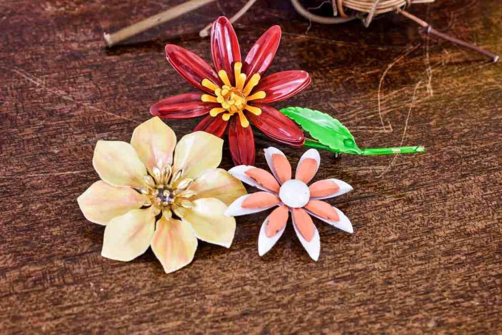 three vintage enamel floral brooches
