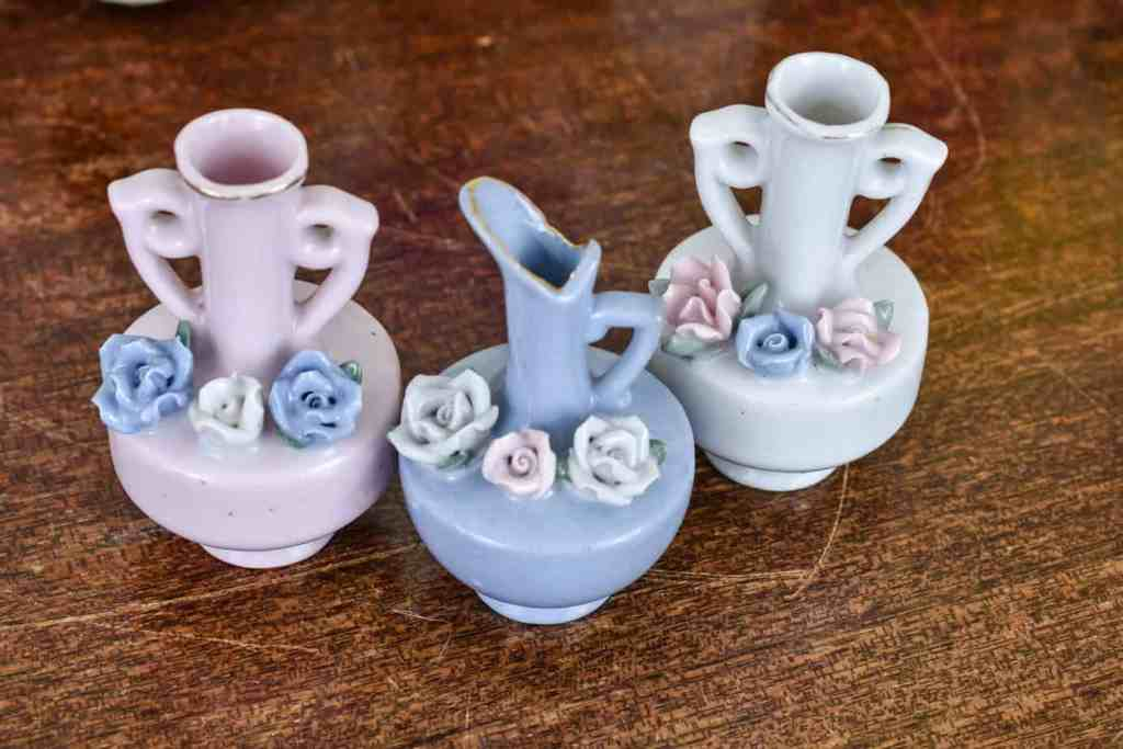 three mini pastel bud vases in pink, blue and white with rose motifs