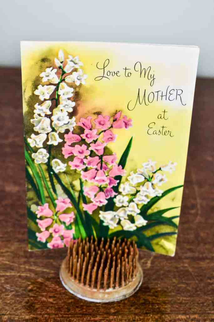vintage Easter greeting card with a Lily of the Valley motif standing in an old flower frog