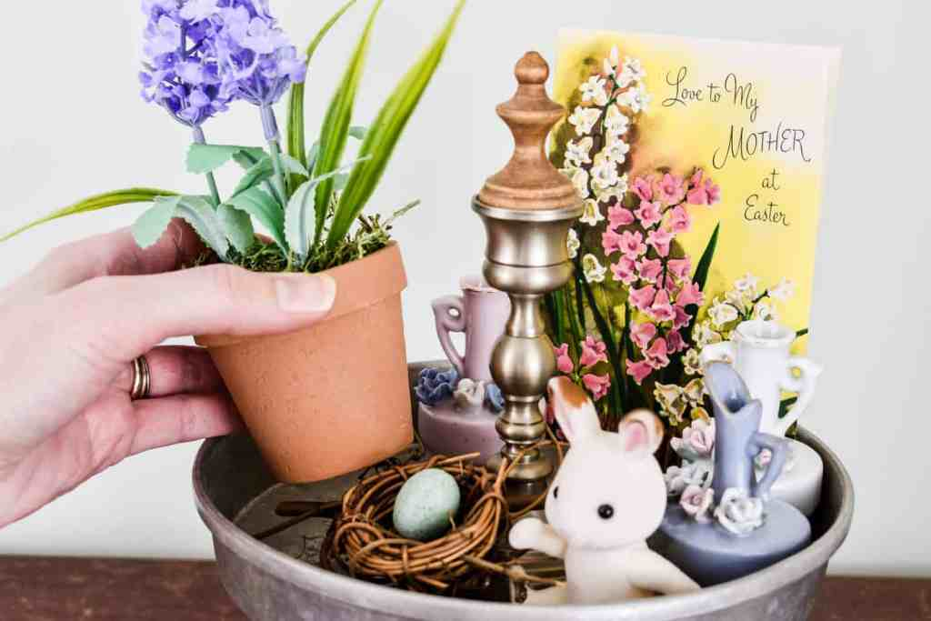 placing a faux potted lavender plant in the top tier of an Easter Tiered Tray