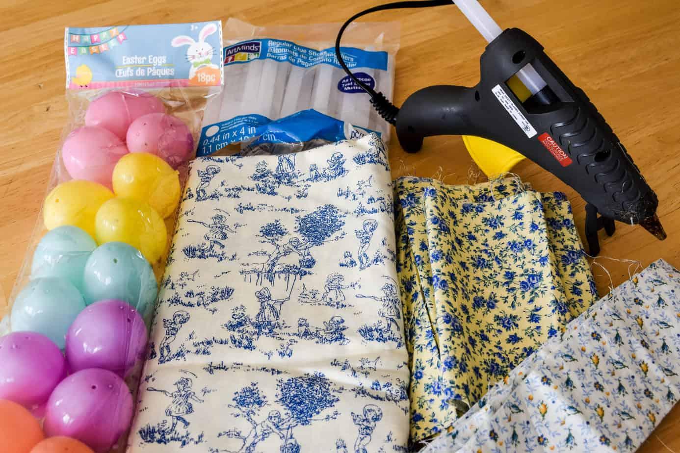 plastic Easter eggs, three types of blue fabric, hot glue gun and glue sticks