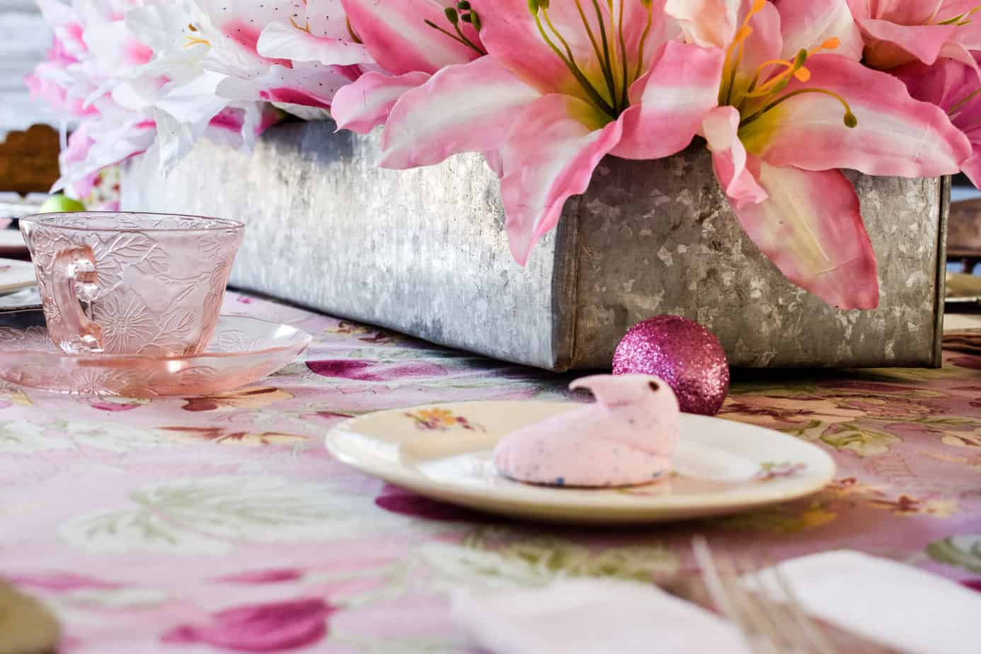 long galvanized metal planter tray filled with faux lilies on a pink Easter tablescape
