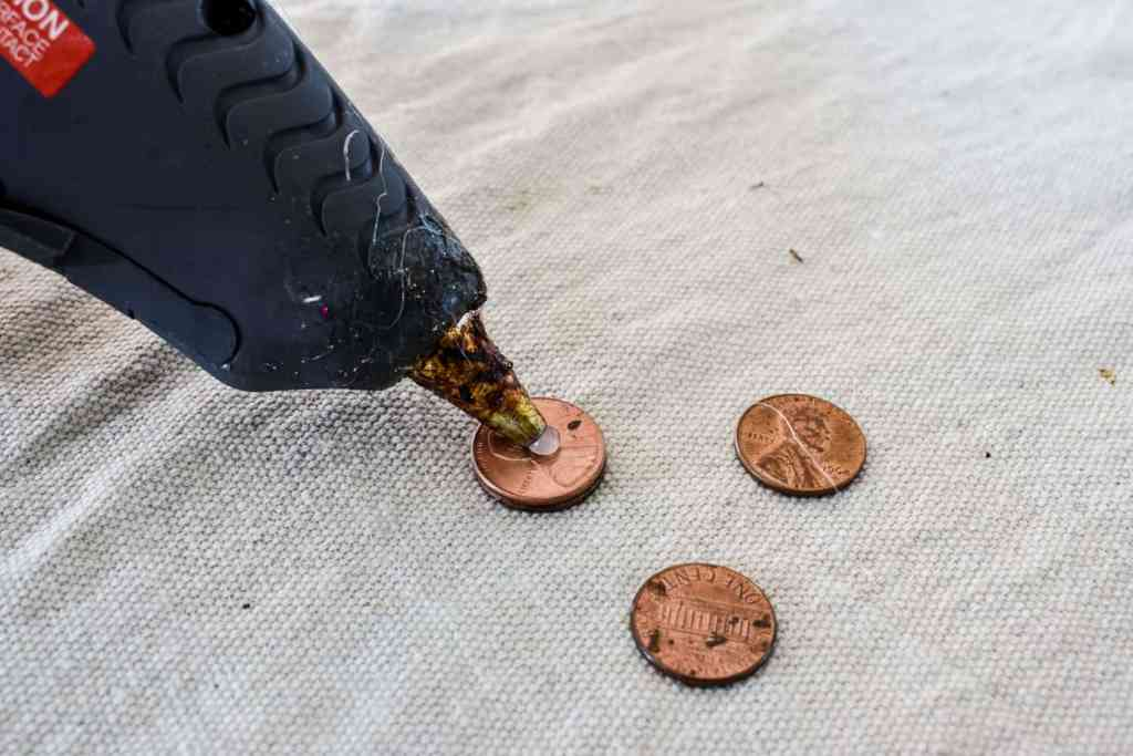 glueing pennies together with hot glue