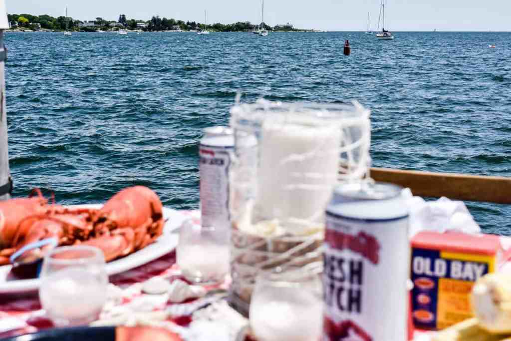 blurred tablescape with ocean and boats in focus in the background
