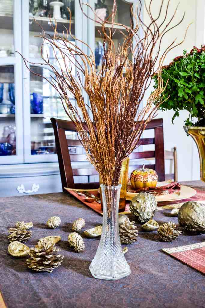 sparkly brown and gold floral filler in a vase on a fall tablescape