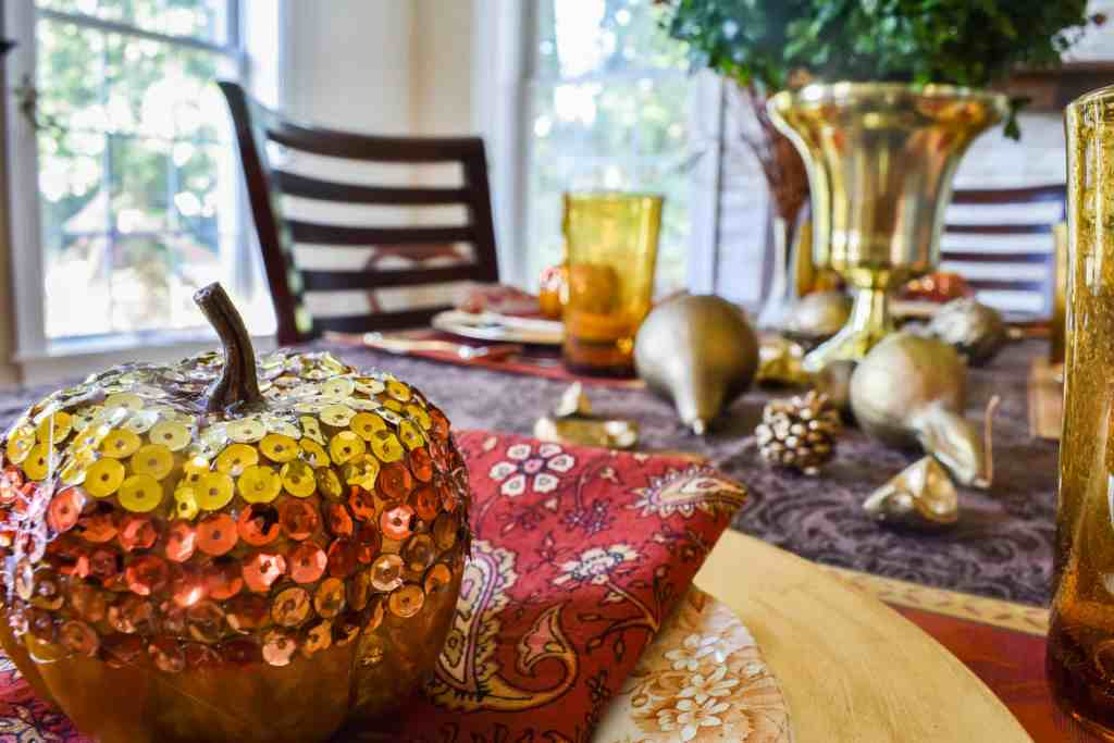 sequin glam pumpkin close up on a fall table setting