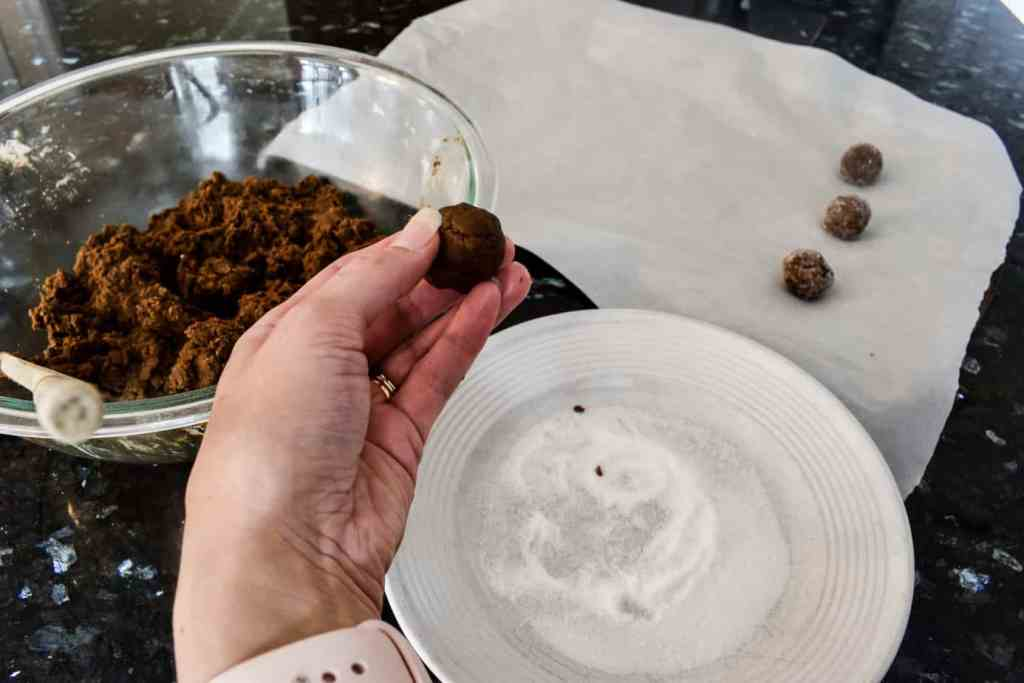 rolling ginger snap dough into balls
