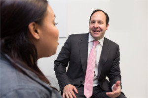 Dr. Zuckerman speaks with a cosmetic surgery patient.