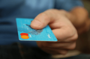a person holding a credit card