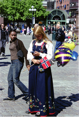 Norwegian In Costume On Phone
