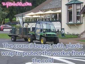 The council buggy with plastic wrap to protect the worker from the cold
