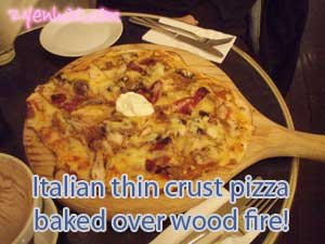 Italizan thin crust pizza baked over wood fire!