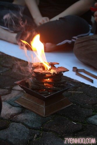 A sample of the agnihotra fire burning the dried cow dung in a copper pyramid
