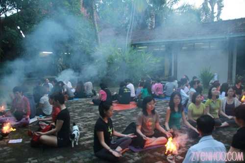 Smoke from the agnihotra fire covering the circle of participants