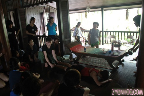 James' demonstrating Zen Thai massage on another volunteer