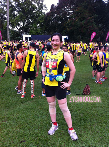 Me with my finisher medal at the field after the run. Woohoo!!