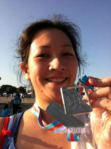 Me with the RHB Half Marathon finisher medal