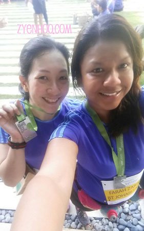 Farah and I with our finisher medals. Yay!