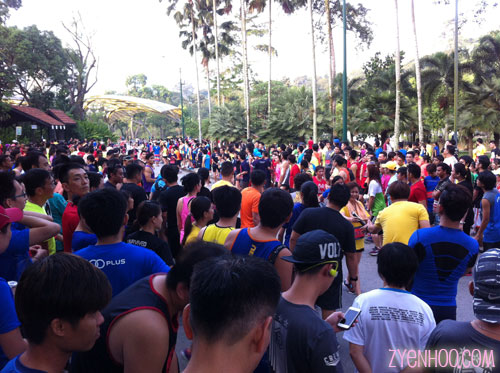 Everyone waiting for the runners to complete their loops