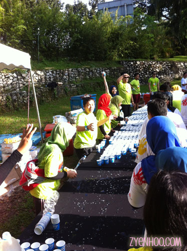 The poor volunteers handing out water in the glaring sun