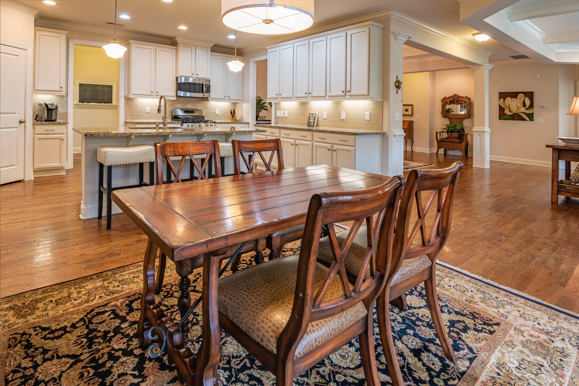 rectangular brown wooden dining table and wooden chairs