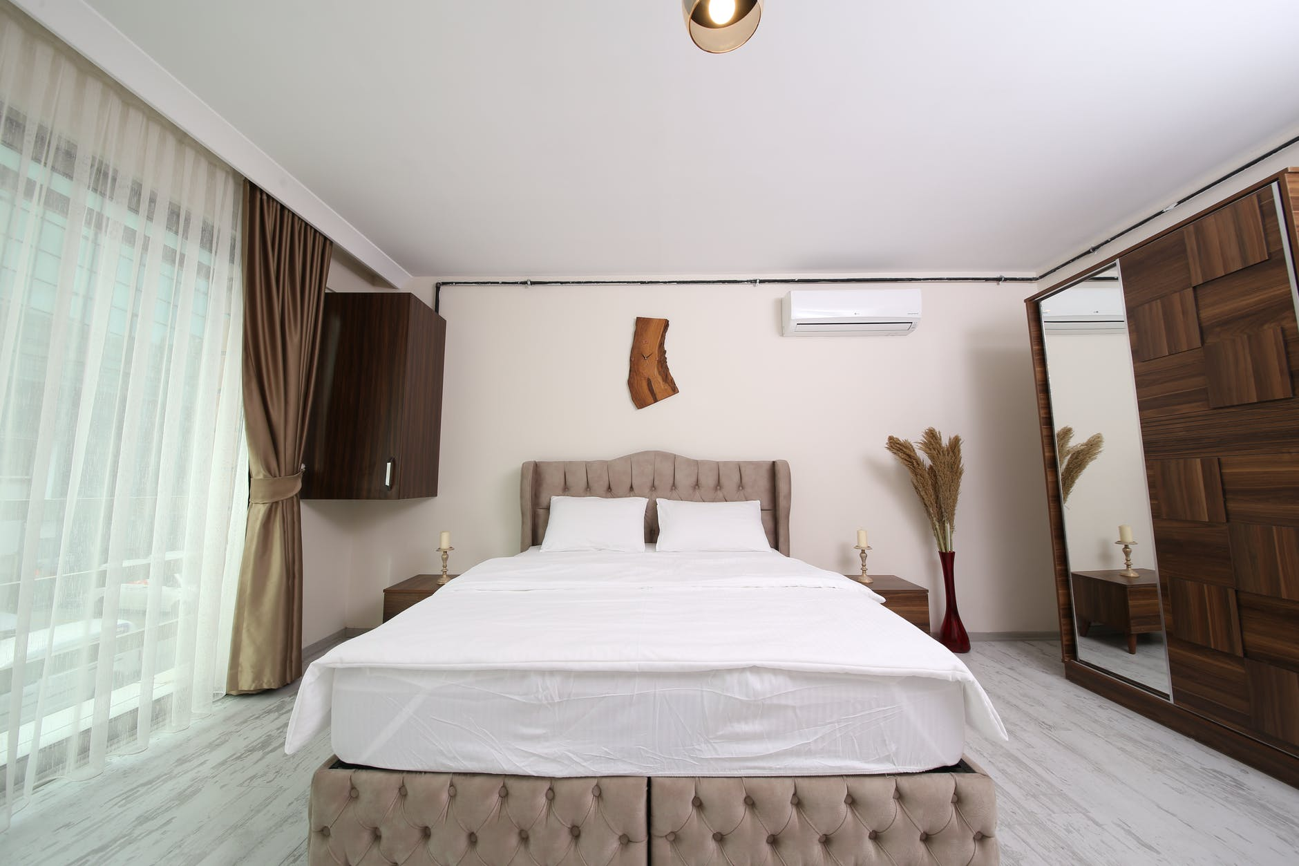 white bed linen with brown bed frame