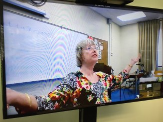 Instructor Julie Percell addresses the class from the Kaua'i Community College location.