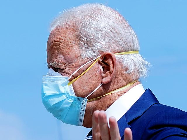 Democratic presidential candidate former Vice President Joe Biden wears two face masks as he arrives at Fort Lauderdale-Hollywood International Airport, in Fla., Oct. 13, 2020. (AP Photo/Carolyn Kaster)