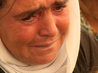 Yazidi mother weeps, CBN News image, Jonathan Goff