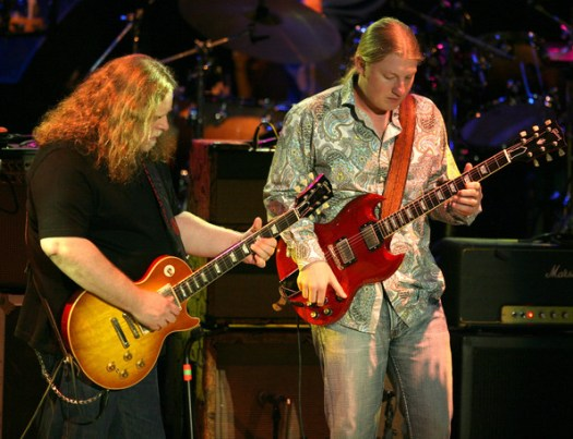 Derek Trucks Guitarists Warren Haynes and Derek Trucks perform in concert with the Allman Brothers Band at the Greek Theater on May 20, 2009 in Los Angeles, California.  (Photo by Angela Weiss/Getty Images) *** Local Caption *** Warren Haynes;Derek Trucks