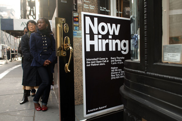 People wait in line outside an American Apparel store December 4, 2008 in New York City. While unemployment in Manhattan is sharply up, American Apparel has been holding bi-weekly open calls for jobs at the youth oriented clothing store. Sales increased 6% for the month of November 2008 at American Apparel stores compared to November last year.