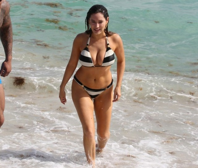 Kelly Brook Relaxes At The Beach