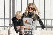 """Couple Fergie and Josh Duhamel take their son Axl out for breakfast in Brentwood, California on December 27, 2014. Fergie has been busy these last few months recording her second solo album due for release early next year and recently released her first single """"LA Love (La La)."""""""