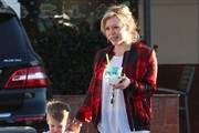 Singer and actress Hilary Duff takes her son Luca to get some frozen yogurt in Studio City, California on December 28, 2014. Luca was so excited to get yogurt he was trying to eat his on the way to the car and got most of it on his face.
