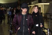 Singer Joe Jonas catches a flight out of Dulles International Airport in Washington, D.C. on December 12, 2014. Joe was recently seen partying in Miami with the likes of Miley Cyrus and Leonardo DiCaprio during Art Basel.