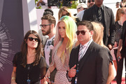 Singer Kesha (C) attends the 2014 MTV Video Music Awards at The Forum on August 24, 2014 in Inglewood, California.