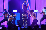 Rapper Nicki Minaj (C) performs onstage during the 2014 iHeartRadio Music Festival at the MGM Grand Garden Arena on September 19, 2014 in Las Vegas, Nevada.