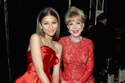 Zendaya Coleman (L) and Barbara Eden pose backstage at the Go Red For Women Red Dress Collection 2015 presented by Macy's fashion show during Mercedes-Benz Fashion Week Fall 2015 at The Theatre at Lincoln Center on February 12, 2015 in New York City.