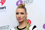 Musician Iggy Azalea poses backstage at the Q102's Jingle Ball 2014 at Wells Fargo Center on December 10, 2014 in Philadelphia, Pennsylvania.