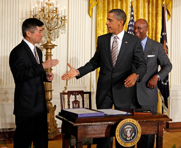 Barack Obama U.S. President Barack Obama (C) shakes hand with Commerce Secretary Gary Locke (L) and U.S. Trade Representative Ron Kirk after signing the U.S. Manufacturing Enhancement Act during a ceremony in the East Room of the White House August 11, 2010 in Washington, DC. The law contains hundreds of tariff suspensions and reductions on products that U.S. manufacturers use in domestic production. The National Association of Manufacturers says the new law will increase production by $4.6 billion and support 90,000 American jobs.