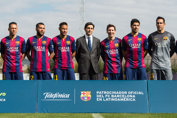 (L-R) Adriano Correia, Dani Alves, Neymar, Telefonica CEO Jose Maria Alvarez Pallete, Lionel Messi, Luis Suarez and Claudio Bravo of FC Barcelona pose during the presentation of a partnership agreement at Ciudad Deportiva de Sant Joan Despi on February 18, 2015 in Barcelona, Spain.