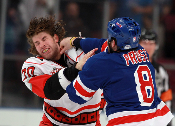 Brandon Prust Troy Bodie #20 of the Carolina Hurricanes and Brandon Prust #8 of the New York Rangers fight during the first period at Madison Square Garden on January 5, 2011 in New York City.