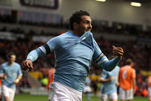 Carlos Tevez Carlos Tevez of Manchester City celebrates scoring the opening goal during the Barclays Premiership match between Blackpool and Manchester City at Bloomfield Road on October 17, 2010 in Blackpool, England.