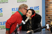 """(EXCLUSIVE COVERAGE) Charli XCX (R) and Uncle Johnny visit """"The Elvis Duran Z100 Morning Show"""" at Z100 Studio on December 12, 2014 in New York City."""