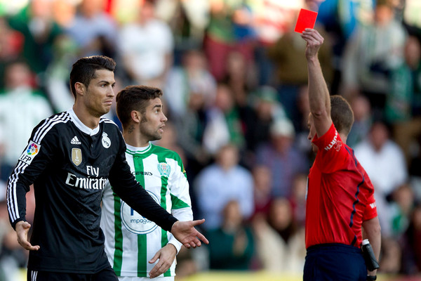 Referee Hernandez Hernandez (L) shows the red card to Cristiano Ronaldo (L) of Real Madrid CF during the La Liga match between Cordoba CF and Real Madrid CF at El Arcangel stadium on January 24, 2015 in Cordoba, Spain.