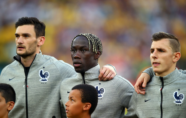 (L-R) Hugo Lloris, Bacary Sagna and Lucas Digne of France look on during the National Anthem prior to the 2014 FIFA World Cup Brazil Group E match between Ecuador and France at Maracana on June 25, 2014 in Rio de Janeiro, Brazil.