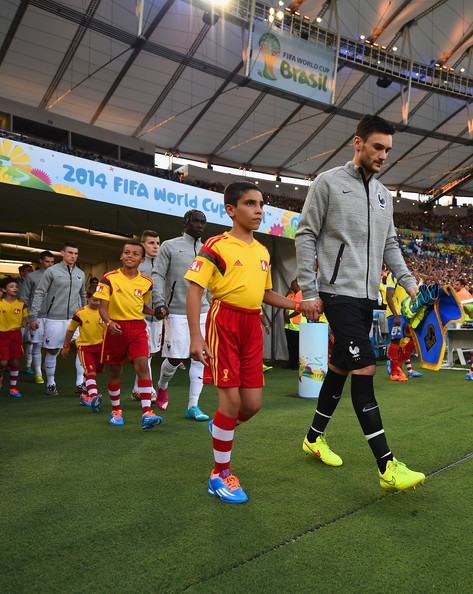 Hugo Lloris of France leads his team to the field with their player escotrs prior to the 2014 FIFA World Cup Brazil Group E match between Ecuador and France at Maracana on June 25, 2014 in Rio de Janeiro, Brazil.