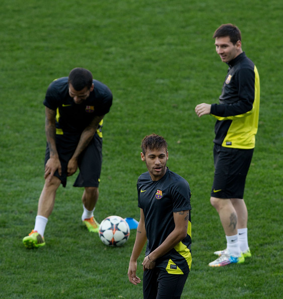 Neymar JR. (R) of FC Barcelona jokes ahead his teammates Lionel Messi (R) and Dani Alves during the training session the day before the UEFA Champions League Quarter-final match between Atletico de Madrid and FC Barcelona at Vicente Calderon Stadium on April 8, 2014 in Madrid, Spain.